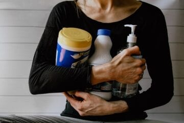 Image of woman holding cleaning products